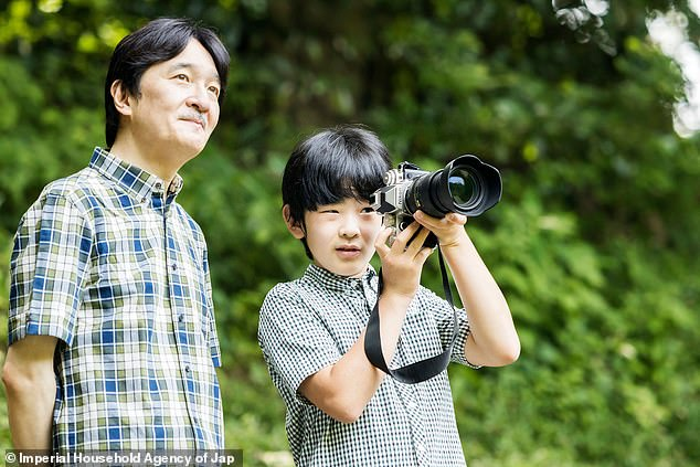 Prince Hisahito of Japan turned 14 this weekend and the Japanese imperial family celebrated by releasing new pictures. The snaps showed the teenager with his father, Fumihito, Prince Akishino, 54, in the garden of their Tokyo residence