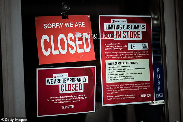 Shops on Sydney Road in Brunswick display signs informing customers of their closure on August 5 amid the pandemic and second outbreak in Victoria