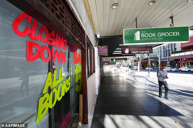 Almost a million businesses could be forced to close over the next three months, according to grim modelling. Pictured: A closed shop in Melbourne