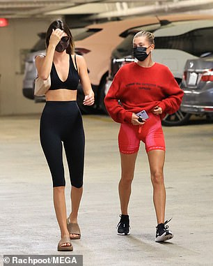 Despite the summer heatwave: Model Hailey donned a large and heavy-looking ribbed red Comme des Garmans Supreme sweater
