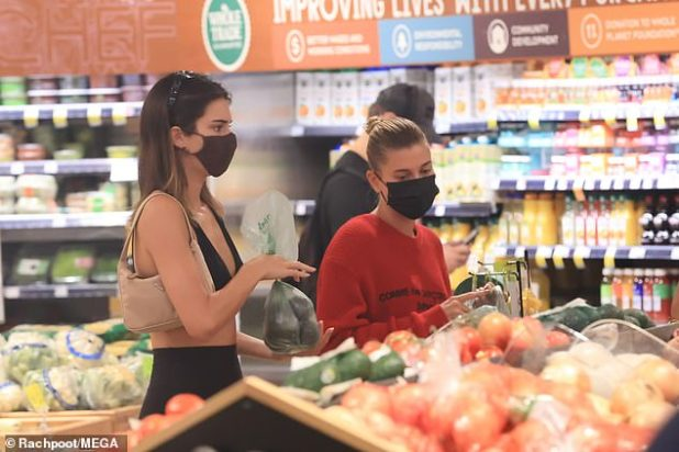 Changing Your Fruits and Vegetables: Jenner completes her ensemble with a light beige purse worn over her shoulder, while Bieber did not carry the bag