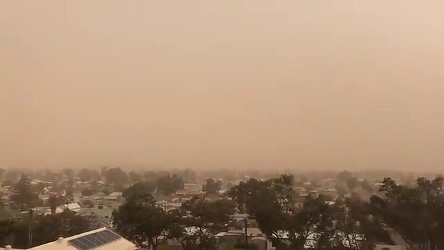 The low pressure trough is expected to weaken as it moves across the country with strong winds expected to ease by Tuesday afternoon (dust storm in Broken Hill pictured on Monday)