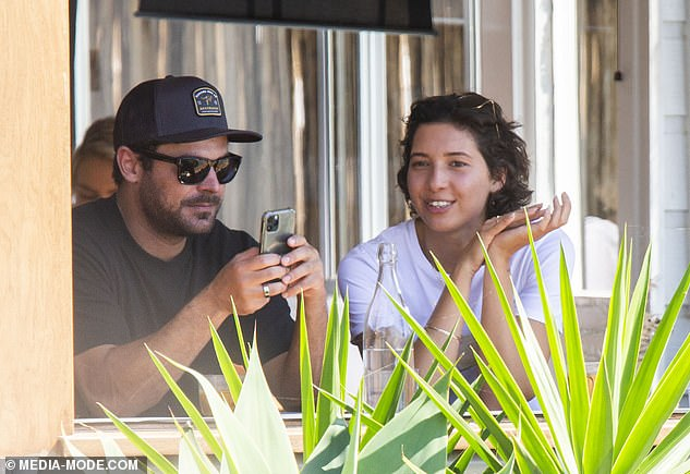 From waiting tables to snagging A-list arm candy! How Zac Efron's girlfriend Vanessa Valladares quit her job waitressing at the the General Store café in Byron Bay and moved into the actor's home. Pictured together in Lennox Head on Sunday