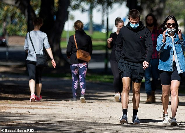 Melburnians are set to endure an extended Stage Four lockdown until the end of September (pictured: residents walking through one of the city's parks for their allowed recreation)