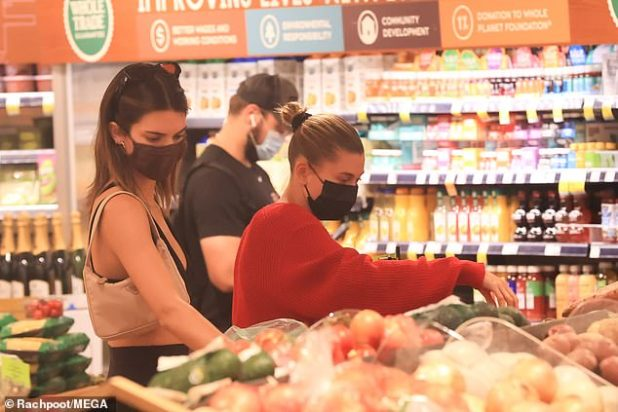 The stars also browse the produce aisle: while Hailey pulled her blond hair backwards into a neat circle, Kendall wore her brown hair down and loose