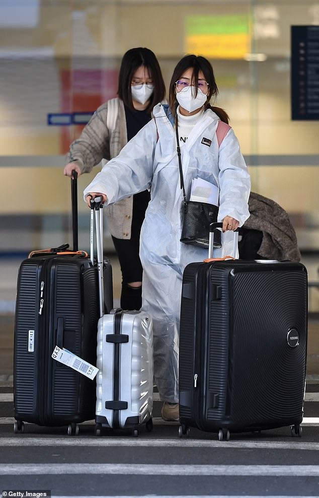 Australians are unlikely to make the most of the safety offer, with overseas travel banned for another three months. Last week the Federal government announced the travel ban had been extended until at least December 17. Pictured: Two women arrive in Sydney in August
