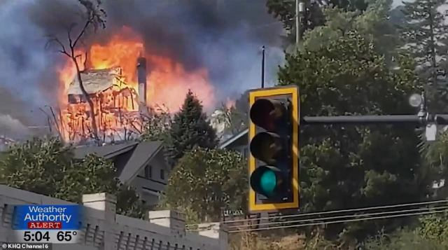 Houses are pictured going up in flames in Malden, Washington, on Sunday as wildfires destroy parts of the northwest