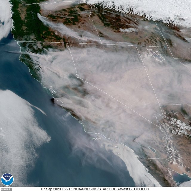 A satellite map from Monday afternoon shows the scale of the wildfires, carpeting much of the Pacific Northwest with smoke