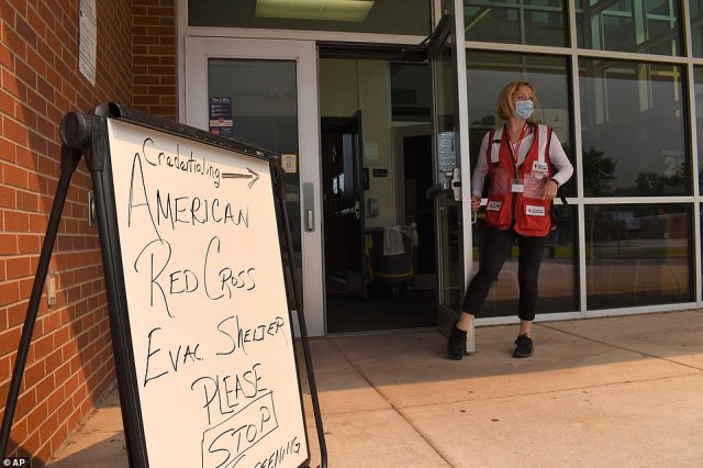 Red Cross volunteer Faith Reihing stands outside a pop-up shelter for evacuees from Cameron Peak wildfire, Colorado