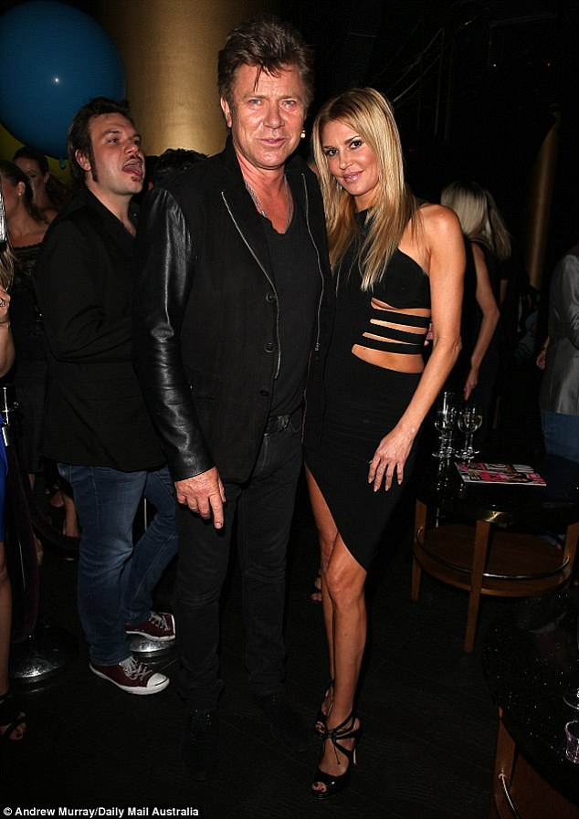 'The police ended up carrying me to my room': The reality star said that she 'almost got arrested' the last time she was in Australia. (Pictured with Richard Wilkins in Sydney in 2014)