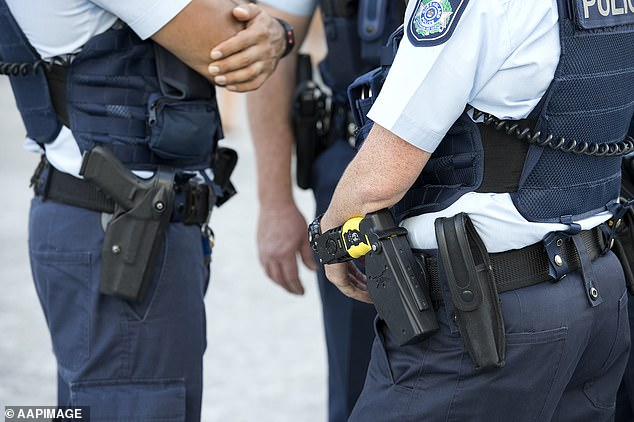 Police raided properties across the Gold Coast and Brisbane on August 1 and detained nine people, including the two male senior constables and a former cop (stock image)
