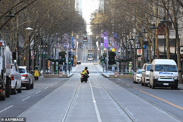 Victoria reported 55 new coronavirus cases and eight deaths on Tuesday. Pictured: A delivery driver is seen on Bourke Street in Melbourne on Sunday