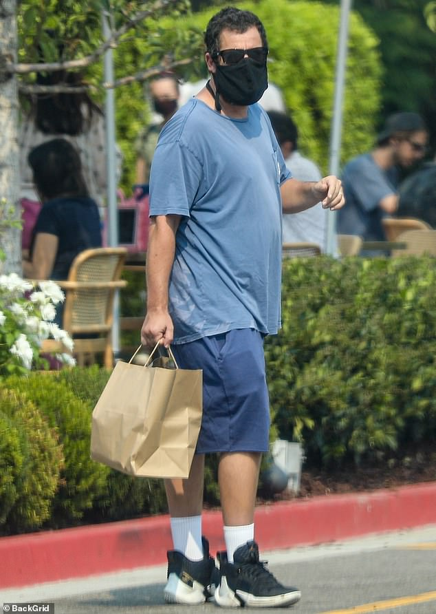 Doting dad: Adam Sandler enjoyed some quality time with his daughter Sunny on Monday in Los Angeles during the Labor Day holiday