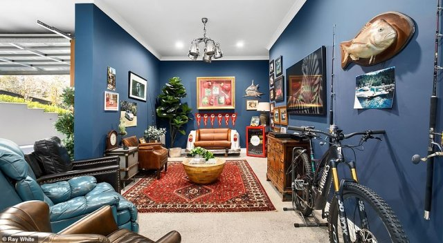 The sitting room with fishing gear and indoor plants was set up in the home's six-car garage and even has its own elevator