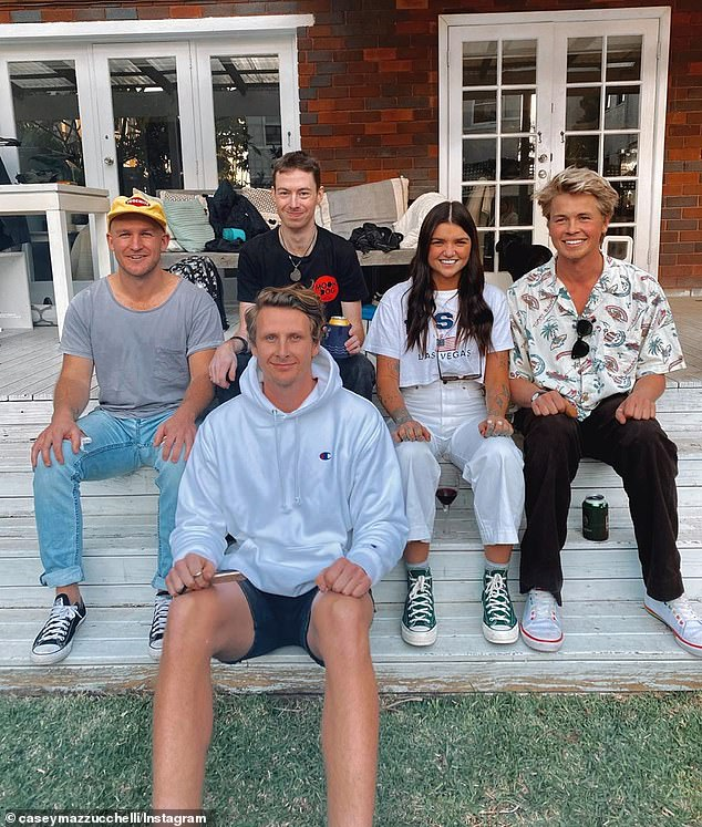 Big Brother pals: There is, however, one photo featuring herself with her Big Brother co-stars Mat Garrick, Daniel Gorringe, Ian Joass andXavier Molyneux (pictured left to right) sitting on the steps of a deck