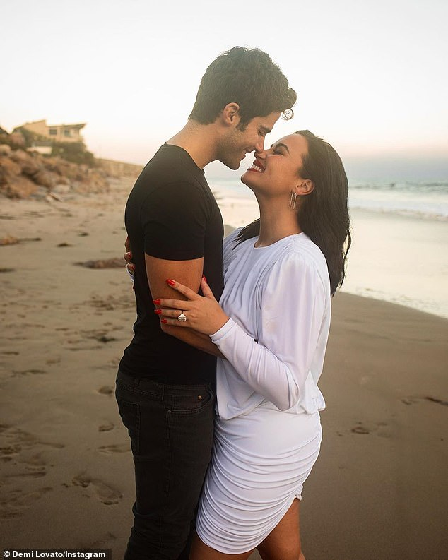 'My fiancé is so positive all the time!' After only four months of love in lockdown, Ehrich popped the question to the former Disney Channel star on a beach (posted July 22)