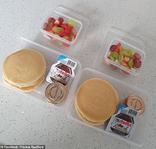 Christa Spafford from Lancashire, was slammed online for sharing a picture of her kids' packed lunches (pictured) because it was too high in sugar