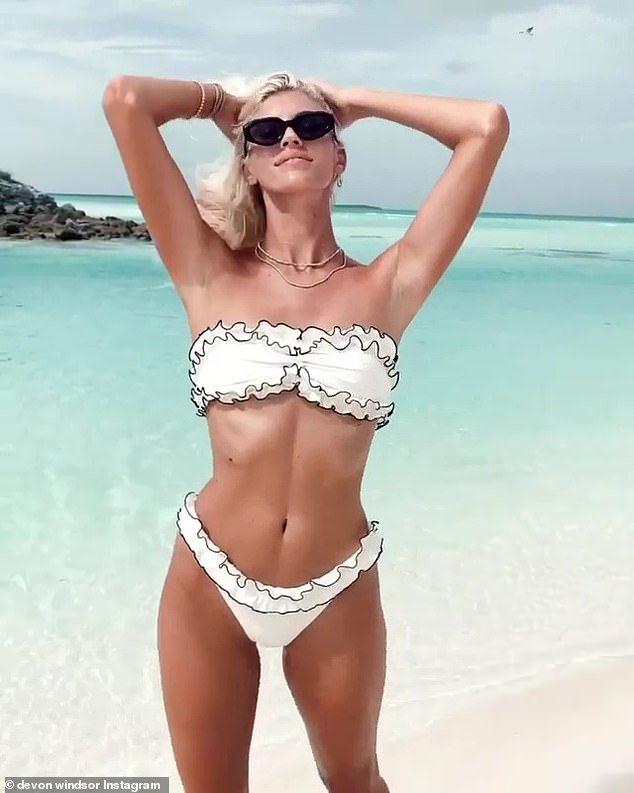Stunning:The supermodel, 26, who has jetted off on an idyllic beach getaway, shared a sizzling video as she showed off one of her designs