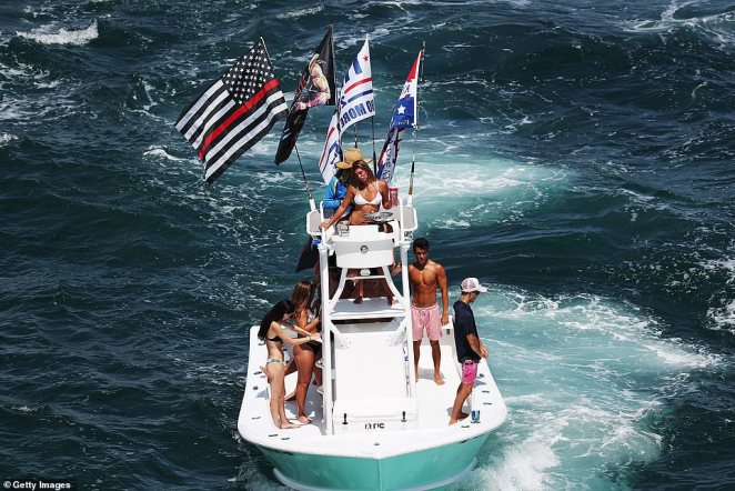 Revellers wearing skimpy bikinis and swimming shorts partied on their boat near the President's Florida home
