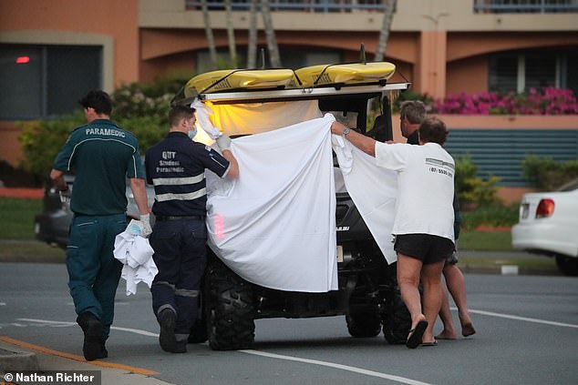 Pictures show paramedics and lifeguards desperately tending to the man's injuries in the back of a beach buggy