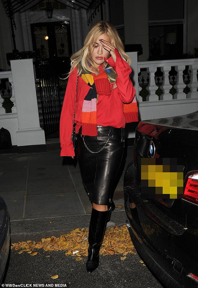Stylish: The star then completed the outfit with racy thigh-high boots and and the multicoloured scarf