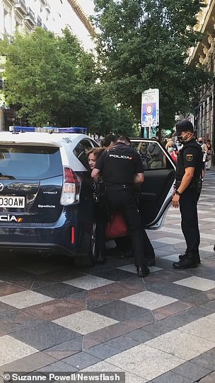 The woman provided staunch resistance to the officers who resorted to forcefully shoving her head into the side of their vehicle