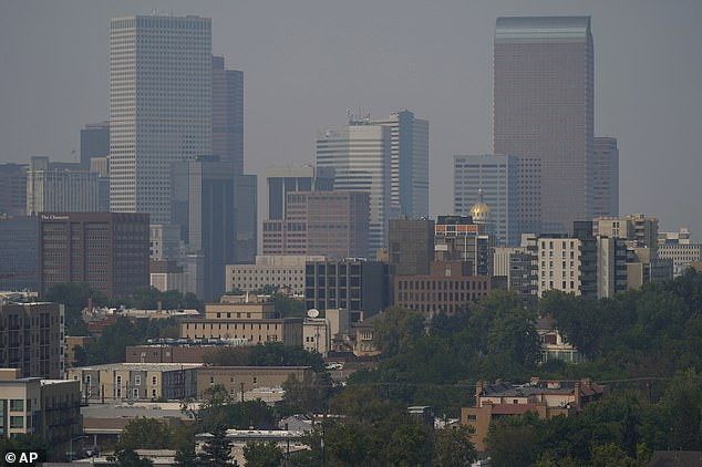 Smoke envelopes the downtown Denver skyline as winds carry the smoky air from the Cameron Peak Fire in Colorado as the Colorado city braces itself for a drastic temperature drop