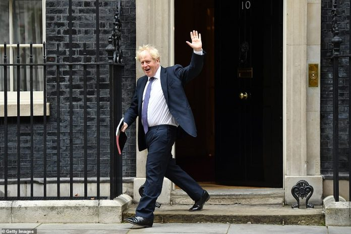 Boris Johnson (pictured leaving Downing Street today) and his senior ministers are holding a socially-distanced meeting with concerns rising about infections - which have neared 3,000 for two days running