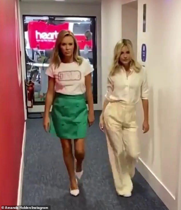 In sync!In the slow motion video, the two stars strutted down the hallway in sync as they sultrily flicked their blonde locks in time