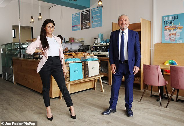 Business partners:The Apprentice host looked in good spirits as he joined Carina at the store and helped her to cut the ribbon on its opening day