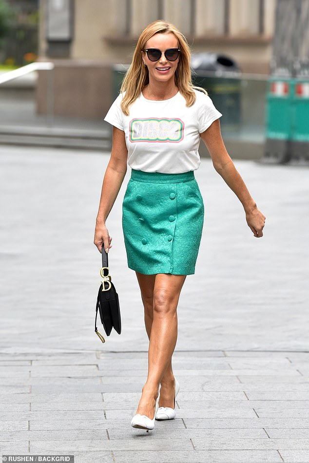 Looking good:Amanda Holden, 49, looked effortlessly stylish in a fun green miniskirt as she strutted out of the Heart Radio studios on Tuesday
