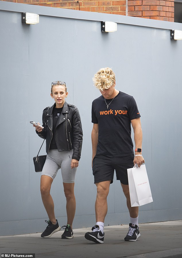 Stroll: He wore a black and orange Tee. He added shorts and trainers to the look as he walked alongside Tiffany