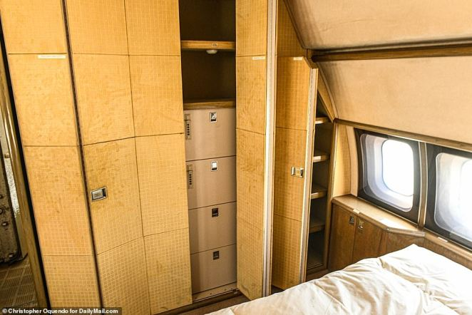 Inside the plane's rear bedroom is a bed and a closet with a chest of drawers, which were emptied out