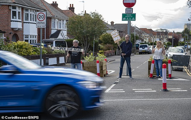 The road closure has left residents furious at the new Government scheme as they now have to take a 'massive detour' to get to their own homes