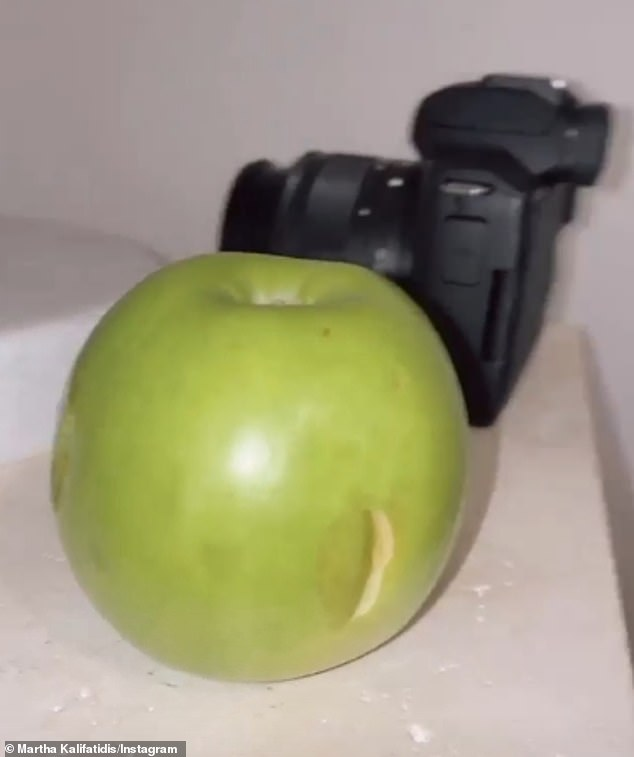 Martha captioned one photo: 'Currently in bed eating a McDonald's 70 cent cone and the apple is sitting on the bedside table with a bite mark'. In an Instagram Stories post, Martha proved her point, showing the apple sitting on the beside table with bite marks in the sides