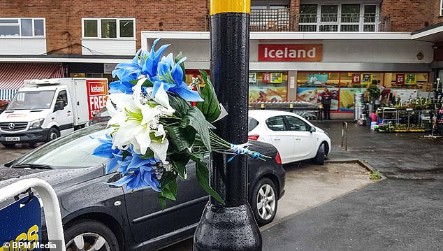 Flowers were left at the scene of the attack, which allegedly started after Mr Momand intervened when his wife was called a p*** c***