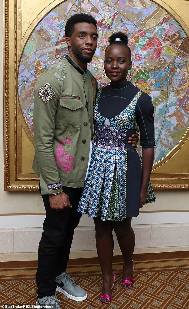 Co-stars: The actress took to Instagram and shared a photo of the late actor laughing as Lupita put her hands on his shoulders (pictured in 2018)