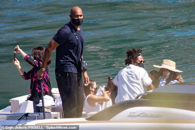 Doting parents: Beyonce appeared to be holding her son Sir, while Rumi stayed close by