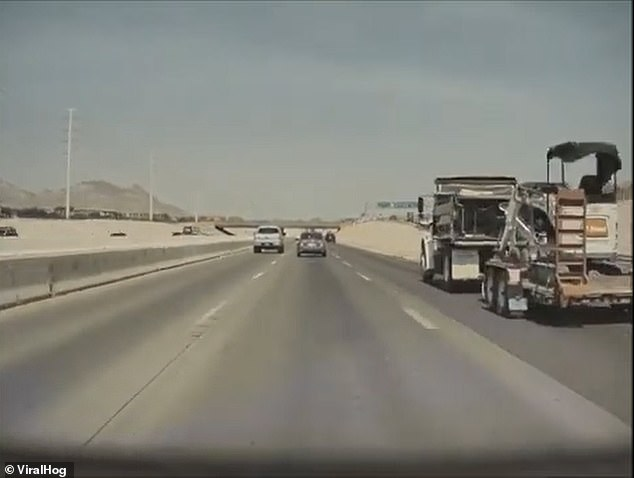 The vehicle approached a large truck, which is seen on the right-hand side