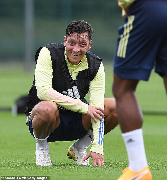 Banned gunners Mesut Ozil were all smiles as he seeks his way into Arteta's plans