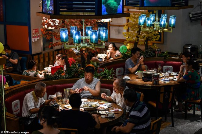 People eat in a restaurant in Wuhan, China's central Hubei province on September 4, 2020. Wuhan was where the virus began
