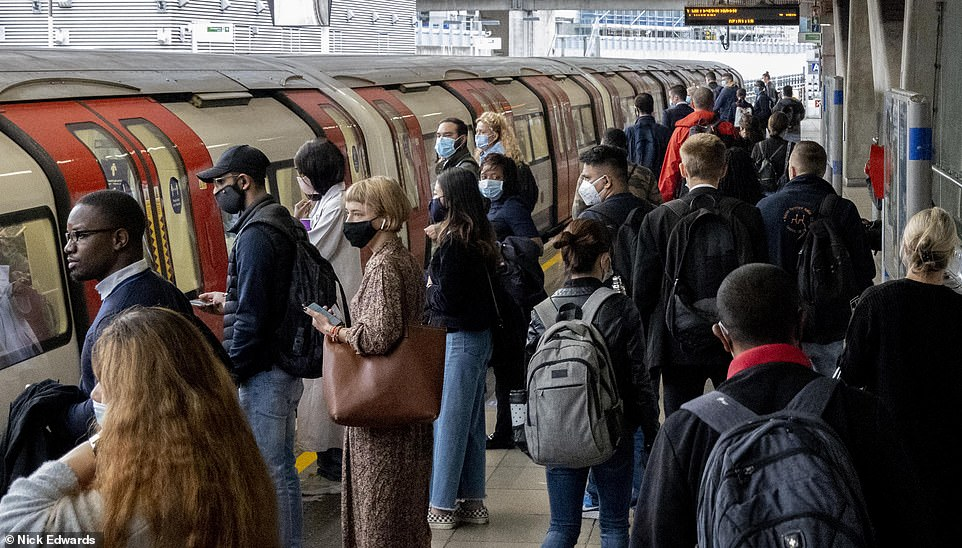 Right from the start of the pandemic, it has been this erosion of the everyday that I've found so hard to come to terms with (Pictured: Passengers wait to board a westbound Jubilee train from Canning Town, East London)