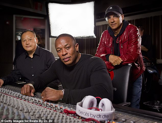 Hip-hop billionaire: Dre is shown with Peter Chou and Jimmy Iovine in August 2011 as they announce a partnership for Beats, which was sold for $3 billion in 2014 to Apple