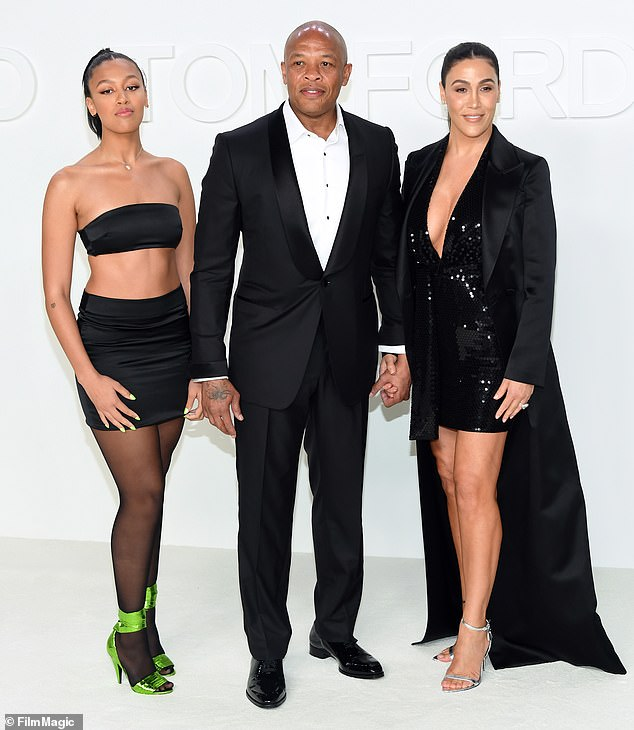 Happier times: Dre is shown holding hands with Nicole and their daughter Truly in February at a fashion show in Hollywood