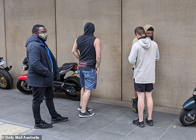 ADF personnel bearing Navy insignia were seen having a smoke break outside the Sofitel hotel on Wednesday