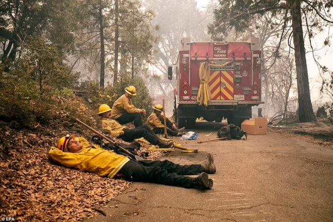 Firefighters (L-R) Rob Spitzer, Max Katay, Josiah Gist and Hunter Grossmann of the Rancheria Station rest on Tuesday