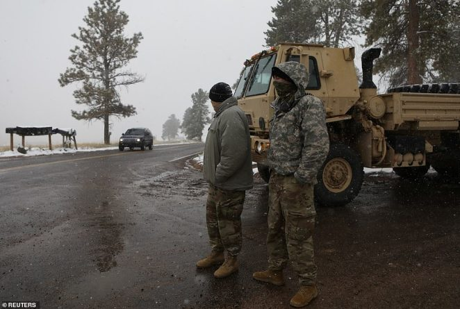 Firefighters in Colorado have been helped by the sudden, unexpected arrival of snow on Tuesday in the state