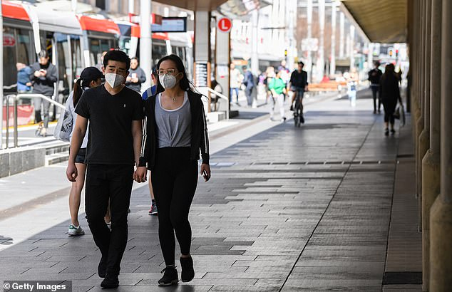 Sydneysiders spotted wearing face masks despite the state recording few cases