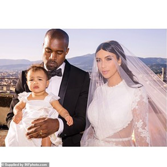 Family: Kanye wore a black custom-made Givenchy suit as their friends, family and then 11-month old daughter North looked on for their ceremony