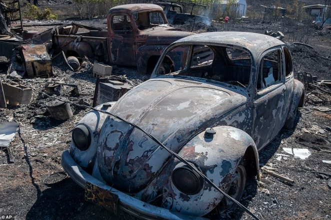 A VW Beetle is charred and destroyed following the wildfire that swept through the Washington town of Malden